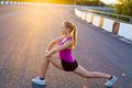 Healthy life young woman is streching outdoors Royalty Free Stock Photography