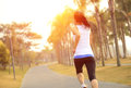 Healthy lifestyle asian woman running beautiful at tropical park Stock Images