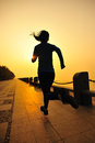Healthy lifestyle beautiful asian woman running at seaside Stock Photography