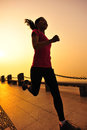 Healthy lifestyle beautiful asian woman running at seaside morning Royalty Free Stock Image