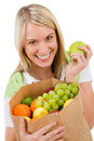 Healthy lifestyle - cheerful woman with fruit Stock Images