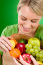 Healthy lifestyle - cheerful woman with fruit Royalty Free Stock Photos