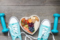 Healthy lifestyle concept with food in heart and sports fitness accessories Royalty Free Stock Photo