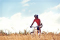 Healthy lifestyle cycling cyclist man riding mountain bike in field horizontal view of Royalty Free Stock Photography