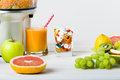 Healthy lifestyle and diet concept. Fruit juice, pills and vitamin supplements, choice concept Royalty Free Stock Photo