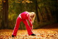 Healthy lifestyle. Fitness girl doing exercise outdoor Royalty Free Stock Photo