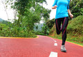 Healthy lifestyle fitness sports woman legs running at park trail Stock Images