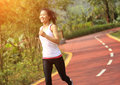 Healthy lifestyle fitness sports woman running at park trail Royalty Free Stock Photo