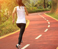Healthy lifestyle fitness sports woman running at park trail Stock Image