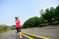 Healthy lifestyle fitness sports woman running at road Royalty Free Stock Images
