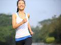 Healthy lifestyle fitness sports woman running at road Stock Photography