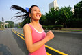 Healthy lifestyle fitness sports woman running at road Stock Photos