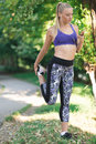 Healthy lifestyle fitness sporty woman running early in the morning in park Royalty Free Stock Photo