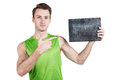 Healthy lifestyle. Portrait of a handsome guy with an empty signboard for writing, wearing sportswear, isolated on white backgroun Royalty Free Stock Photo