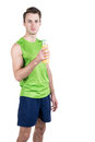 Healthy lifestyle. Portrait of a handsome guy with juice, wearing sportswear, isolated on white background, looking at camera. Ver Royalty Free Stock Photo