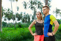Healthy lifestyle runner couple preparing to jog fitness and s sporty standing choosing route for running fit athlete male jogger Royalty Free Stock Photography