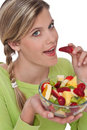 Healthy lifestyle series - Woman eating fruits Royalty Free Stock Photography