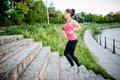 Healthy lifestyle sports woman running on street stairs along ri river Royalty Free Stock Images