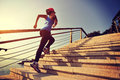 Healthy lifestyle sports woman running up on stone stairs Royalty Free Stock Photo