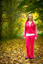 Healthy lifestyle. Sporty active blonde girl outdoor in park Royalty Free Stock Photo