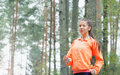 Healthy lifestyle sporty woman running early in the morning in f fitness forest area concept Stock Images