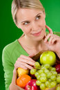 Healthy lifestyle - thoughtful woman with fruit Royalty Free Stock Photo