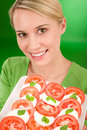 Healthy lifestyle - woman with caprese salad Royalty Free Stock Image