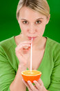 Healthy lifestyle - woman drink juice from orange Royalty Free Stock Photography