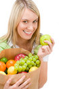 Healthy lifestyle - woman with fruit in paper bag Stock Photos
