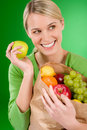 Healthy lifestyle - woman with fruit in paper bag Stock Images