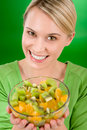 Healthy lifestyle - woman holding fruit salad bowl Royalty Free Stock Images