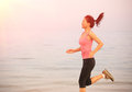 Healthy lifestyle woman running on beach young fitness asian Royalty Free Stock Photos