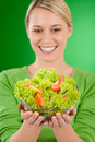 Healthy lifestyle - woman with vegetable salad Royalty Free Stock Photography