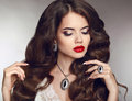 Healthy long hair. Makeup. Jewellery and bijouterie. Beautiful b Royalty Free Stock Photo