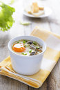 Healthy lunch baked egg with mashrooms and chive dairy cream on wooden table Stock Photo