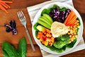 Healthy lunch bowl with avocado, hummus and vegetables Royalty Free Stock Photo