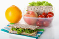 Healthy lunch box filled with fresh fruits vegetables and crispbread Royalty Free Stock Photography