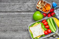Healthy lunch boxes with sandwich, eggs and fresh vegetables, bottle of water, nuts and fruits Royalty Free Stock Photo