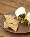 Healthy lunch with a vegetarian wrap Royalty Free Stock Images