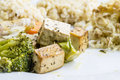 Healthy macrobiotic meal closeup of made of tofu with vegetables and organic brown rice Stock Images