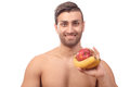 Healthy man with fruits smiling holding whole Stock Photos