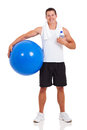 Healthy man gym ball holding a isolated on white Stock Images