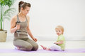 Healthy mother and baby doing fitness Royalty Free Stock Image