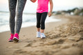 Healthy mother and baby girl walking on beach Royalty Free Stock Photo