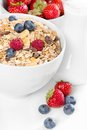 Healthy muesli with fresh berries and milk a bowl of on white background Royalty Free Stock Photos