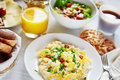Healthy nutricious breakfast food fresh scrambled eggs salad coffee and orange juice concept of or continental Royalty Free Stock Photo