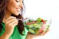 Healthy nutrition close up of pretty girl eating fresh vegetable salad Royalty Free Stock Image