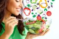Healthy nutrition close up of pretty girl eating fresh vegetable salad Royalty Free Stock Images