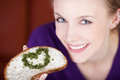Healthy nutrition with heart woman having bread cheese and a of herbs Royalty Free Stock Images