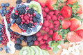 Healthy nutritious fresh fruits on a wooden table Royalty Free Stock Photo